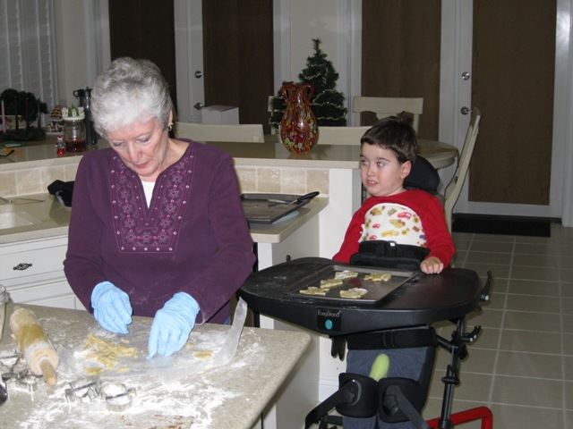 Grandma and Max making cookies