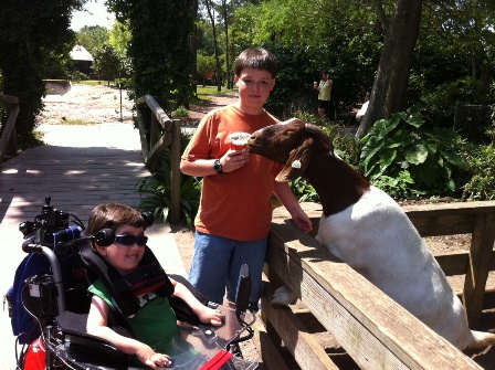 Zoo Hunter and Max with goat